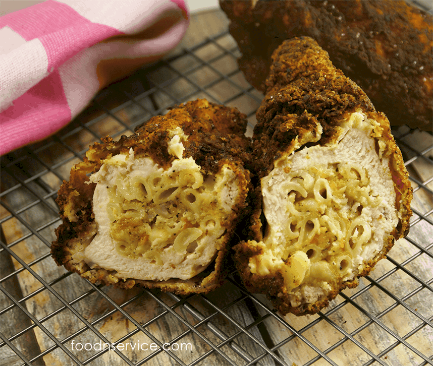 Macaroni and Cheese stuffed fried chicken is sure to be a hit everyone!