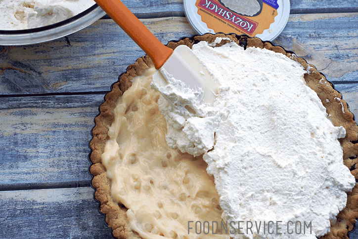 Add in KozyShack® tapioca pudding, and top with whipped cream.