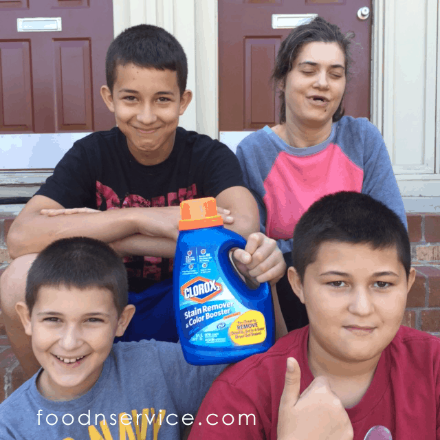 My three nephews and Angela happily posing with a bottle of Clorox2® for me. I like for them to see that their clothes don't magically wash themselves!