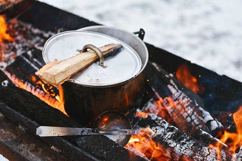 Pot on a campfire stove for walking dead recipes