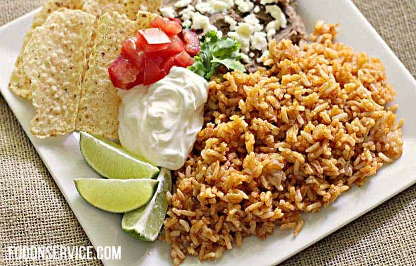 instant pot spanish rice with fresh limes and sour cream