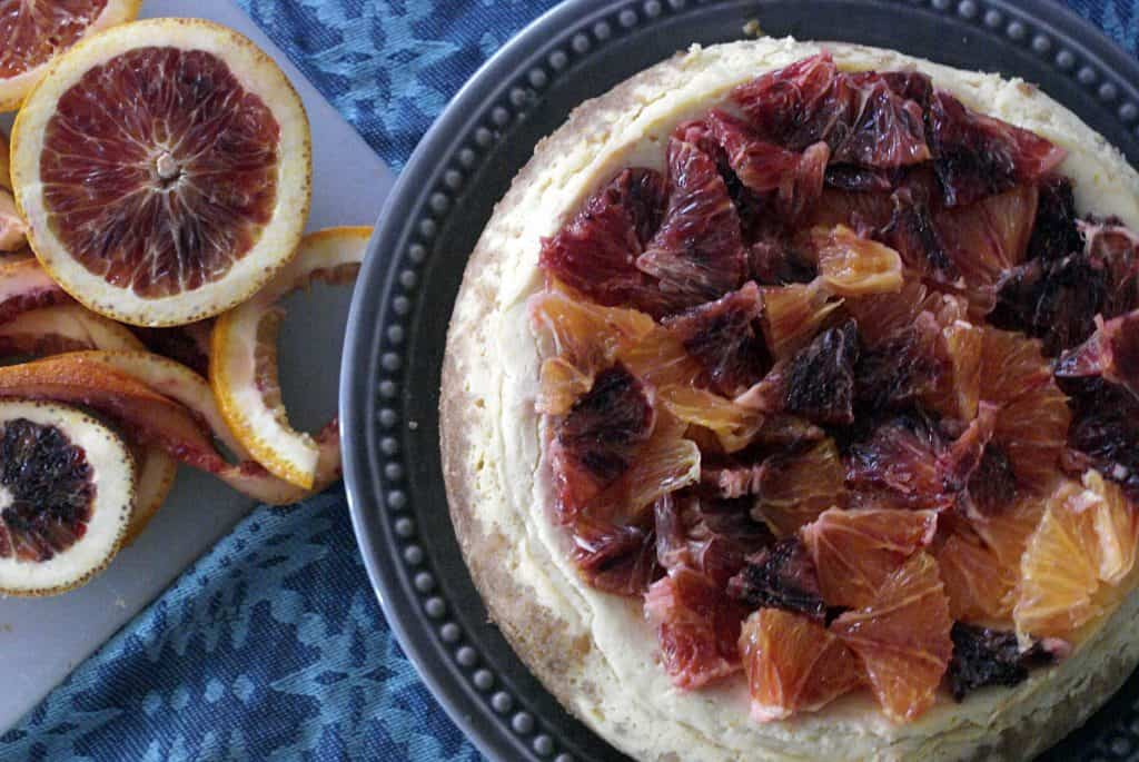 instant pot blood orange cheesecake on a grey plate