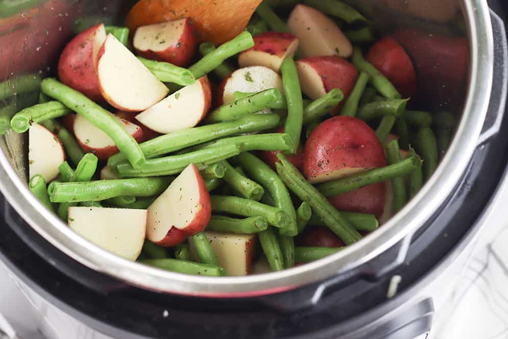 raw green beans and potatoes in an instant pot