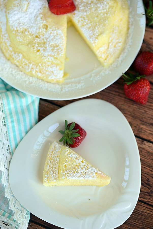 instant pot japanese cheesecake on a white plate with a white a blue striped napkin