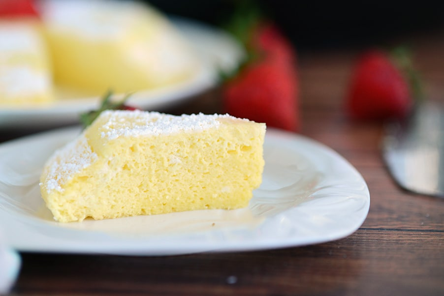 instant pot japanese cheesecake on a white plate on a wooden board