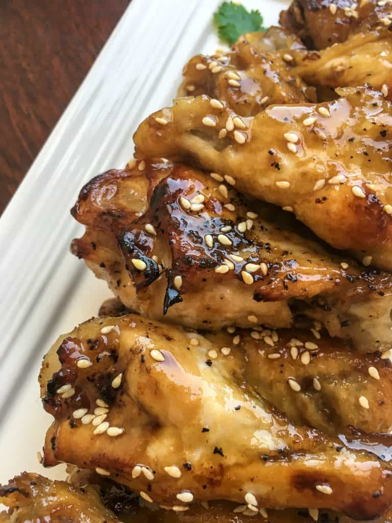 instant pot sesame garlic wings with sesame seeds on top.