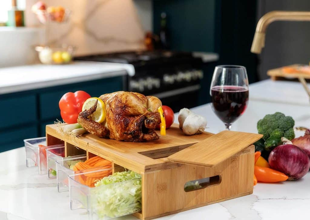 chicken on a cutting board with food prep drawers clever kitchen products item