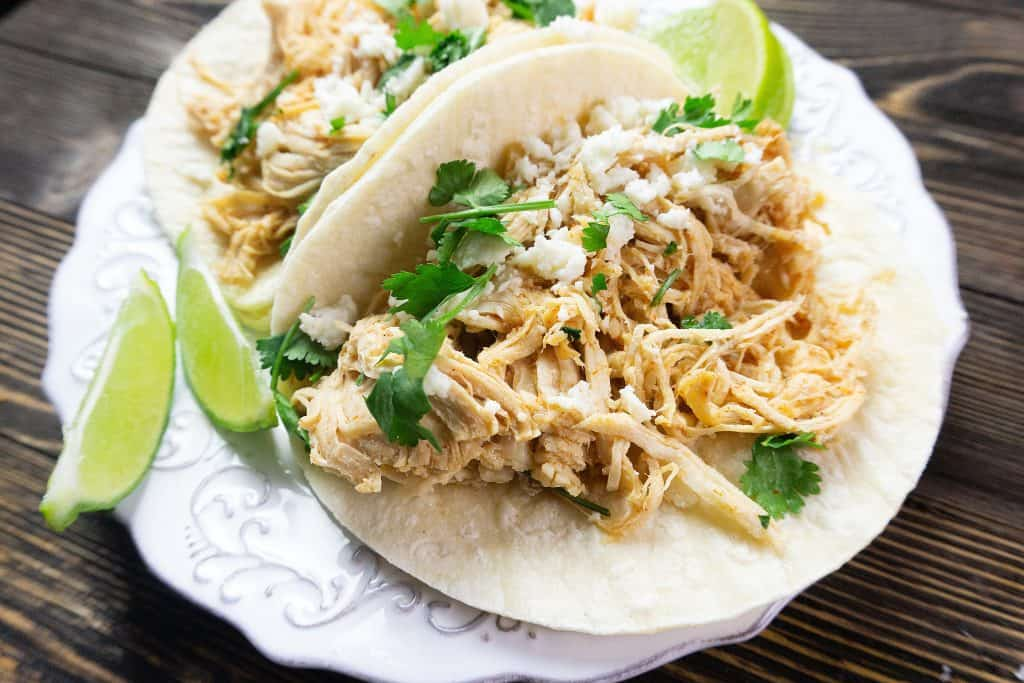 instant pot key lime tacos on a white plate in flour tortillas