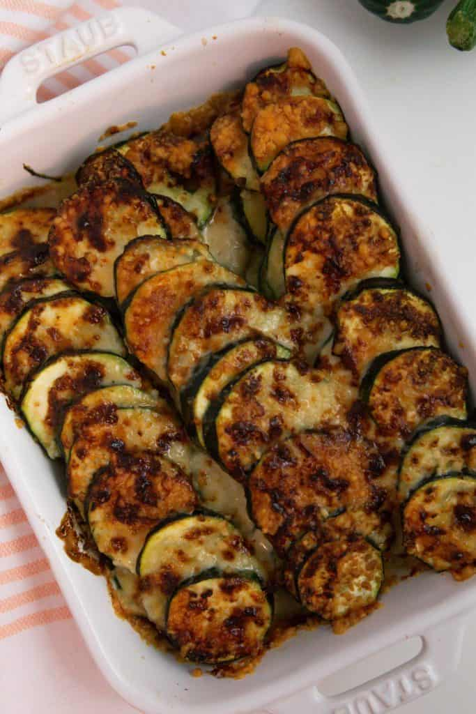 creamy air fryer zucchini casserole recipe in a stave white baking dish
